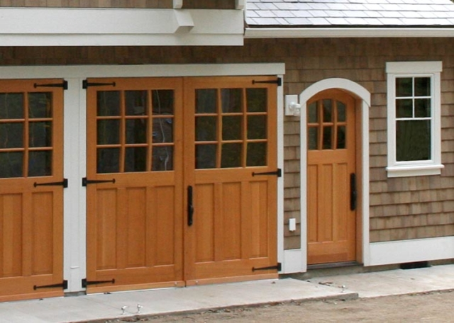 130. Studio Sargent Carriage Doors (SL07) and the Arched Craftsman Traditional Entry Door (ECTL05-A) in Whidbey Island, WA