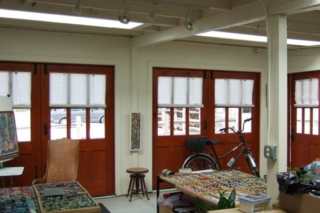 """22. """"The visual gift to the neighborhood was the installation of doors from the Real Carriage Door Company. People walking by stop to admire the doors - I have had oodles of compliments."""" - Sandy of Sandy White Fine Art"""
