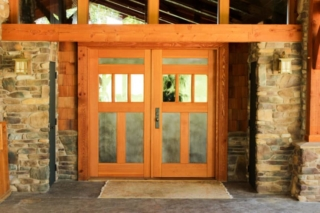 """21. """"Real Carriage doors were the finishing touches. The doors are absolutely beautiful. Everyone at Real Carriage Door helped us so much in making decisions on style, metal choices, hardware, etc."""" - Susan, Hartville, OH"""