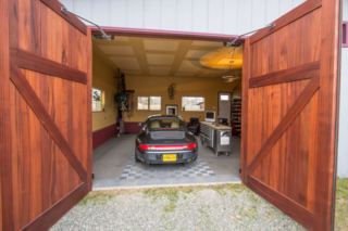 """6. """"We were looking for a clean look with minimum hardware when we discovered Real Carriage Doors. The doors arrived in perfect condition and we installed them with help from some friends in less than one day."""" – Dan"""