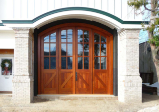 """3. """"We were immediately drawn to Real Carriage Doors not only because of the beautiful work which was displayed on the internet, but because of the outstanding personalized customer service that we received. All of our expectations were met with these beautiful doors."""" –John Buzzi Jr, Sea House Development LLC"""