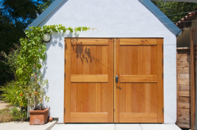 19. Classic Carriage Doors and Plank Entry Door in Palo Alto, CA