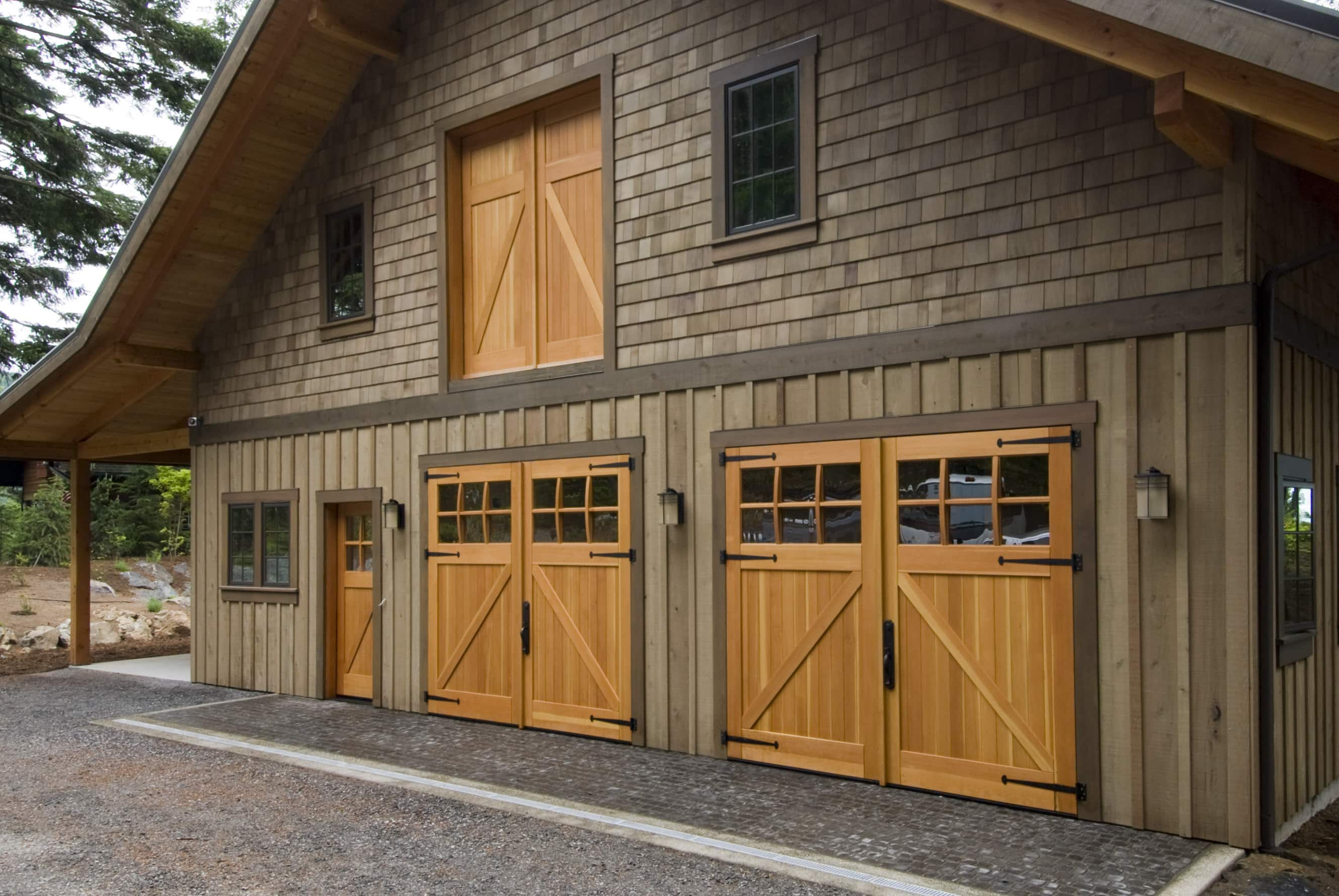 49. CARRIAGE: CL05 Design – Square top, (2x3) lites w/ curved mullions, Z brace w/ tongue + groove panels, Western Red Cedar, w/ bean tip strap hinges & ENTRY: ECL04 Design – Square top, (2x2) lites w/ curved mullions, Z brace w/ tongue + groove panels, Western Red Cedar, w/ butt hinges & LOFT: CL14 Design – Square top, Z brace w/ tongue + groove panels, Western Red Cedar, and butt hinges; Orcas Island, WA