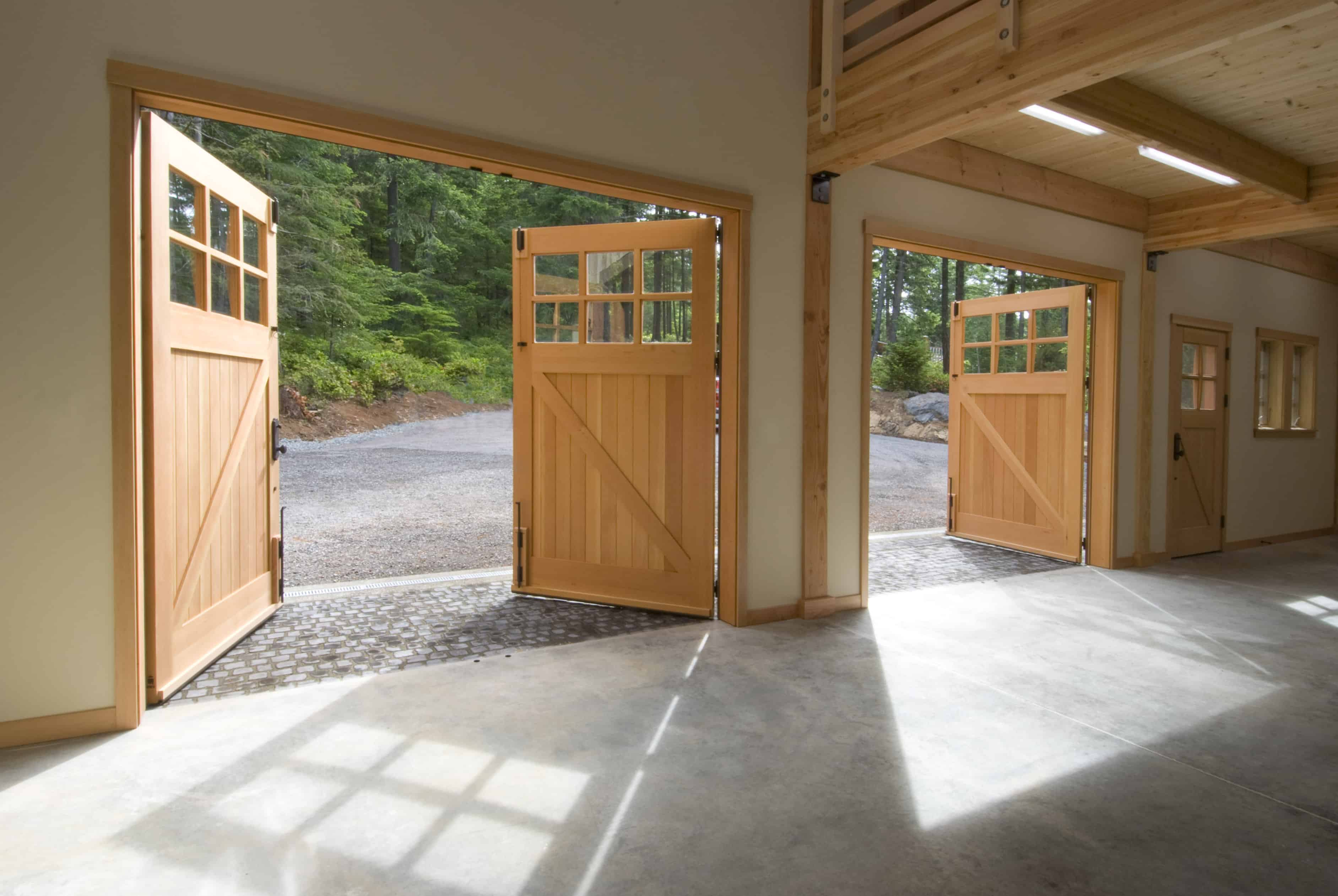 51. CARRIAGE: CL05 Design – Square top, (2x3) lites w/ curved mullions, Z brace w/ tongue + groove panels, Western Red Cedar, w/ bean tip strap hinges & ENTRY: ECL04 Design – Square top, (2x2) lites w/ curved mullions, Z brace w/ tongue + groove panels, Western Red Cedar, w/ butt hinges; Orcas Island, WA