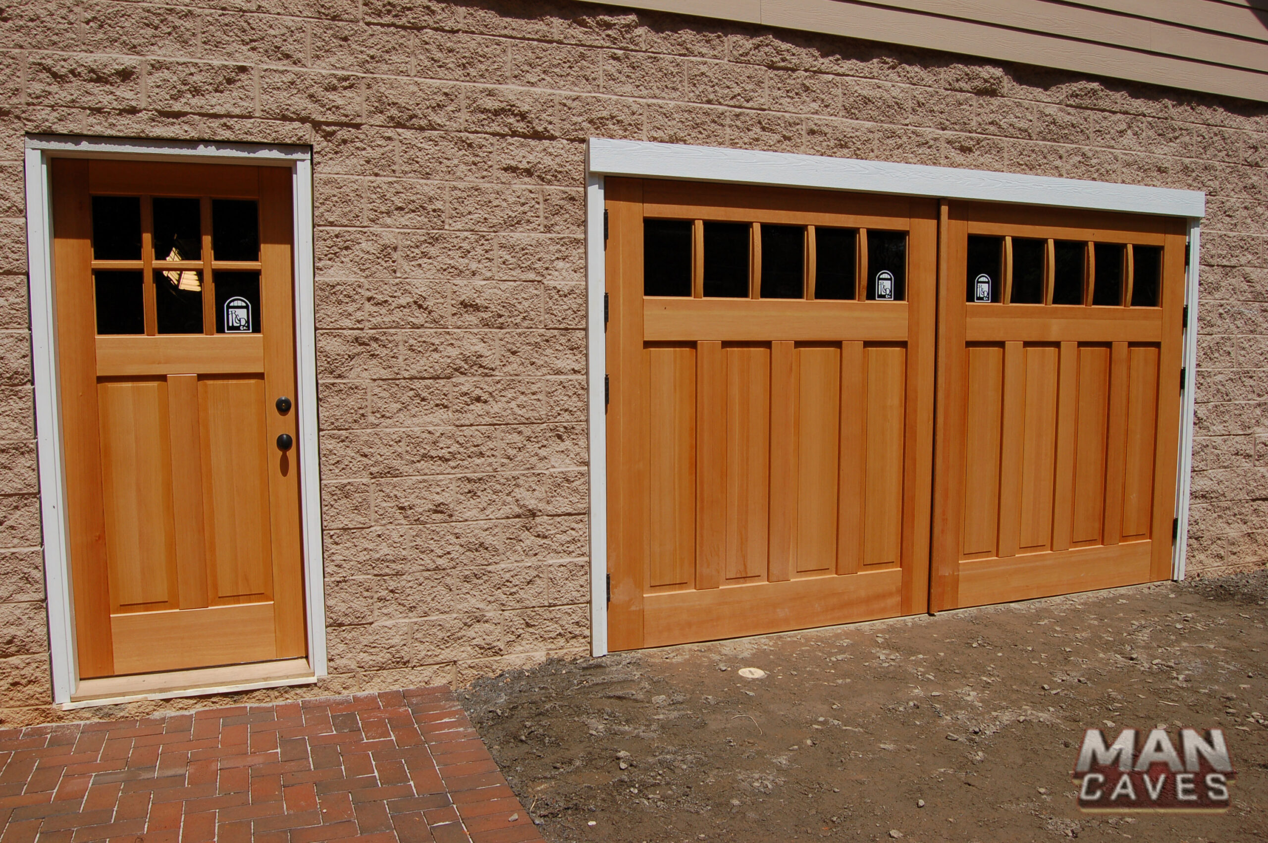 43. Custom Design – Square top, (1x5) lites w/ curved mullions (ext), (4) vertical raised panels, Vertical grain Douglas Fir, butt hinges, and Franklin Auto-swing openers & ECTL05 Design – Square top entry door, (2x3) lites w/ curved mullions (ext), (2) vertical raised panels, Vertical grain Douglas Fir, and butt hinges; Charlotte, N.C. Featured on 'Man Caves'