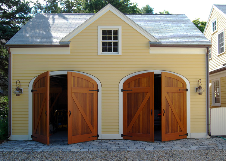 Arched top real wood carriage doors on a garage.