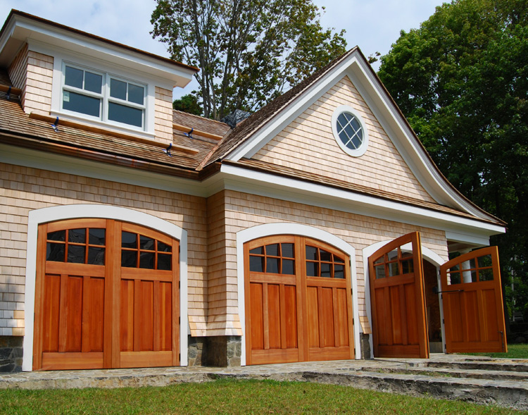Arched top set of carriage doors with glass