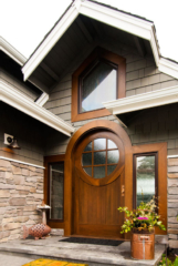 14. Custom Walnut Wood Entry Door with Semi-Circle Arched Top in Gig Harbor, WA