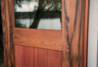 41. Custom Design Outswing Red Wine Redwood w/ scallop panels and Grey lite glass; Gig Harbor, WA