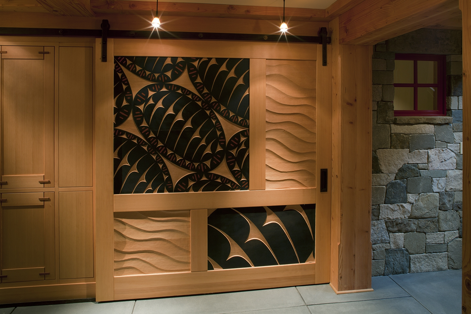 3. Carved Interior Sliding Door in Washington State - Collaboration with Acclaimed Local Carver David Franklin