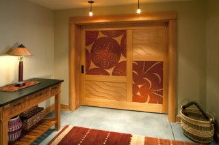 2. Carved Interior Sliding Door in Washington State - Collaboration with Acclaimed Local Carver David Franklin
