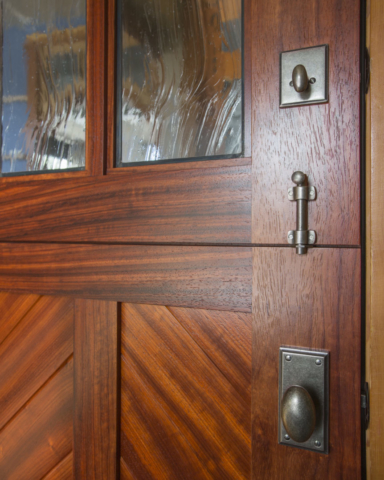 44. 'The Cardinal' Dutch Entry door – Paduak wood w/ Mountain Chevron panel + Seedy Reamy leaded glass – White Medium Bronze Dutch entry hardware; Gig Harbor, WA