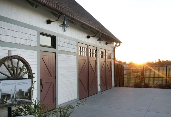 13. ECL15B Design – Square top entry door w/ transom: Classic British X brace w/ tongue + groove panels (no lites), painted, w/ butt hinges & Custom Design – Square top, (2x4) lites, Diamond brace w/ tongue + groove panels, painted, w/ butt hinges; Founder's Park - Anaheim, CA