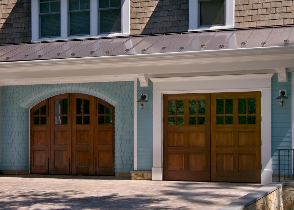 3. A set of bi-folding doors next to a set of outswing carriage doors.