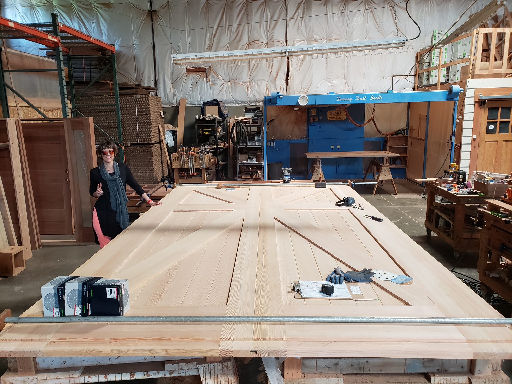 18. A large carriage door being built